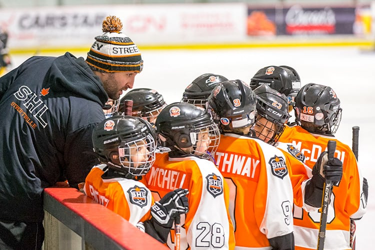 Streetsville Hockey Coach Talking with Players