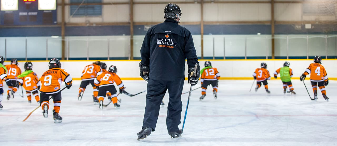 Streetsville Hockey Coach with the team on the ice