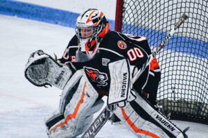 Streetsville Tigers goalie getting ready to stop a puck